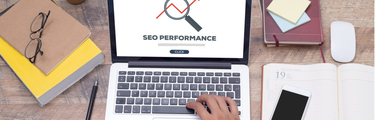 Man searching on laptop for SEO performance